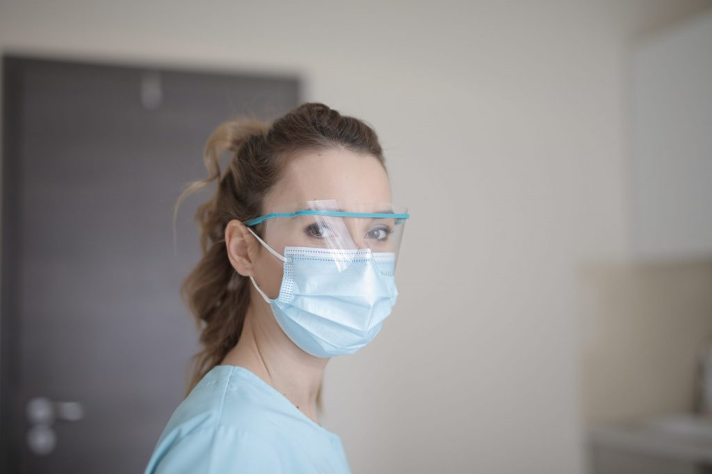Canva - Woman in Blue Shirt Wearing Face Mask